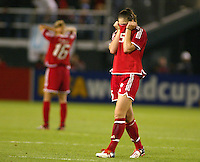 Canada's Andrea Neil (5) and Kara Lang (15) react after losing to Sweden 2-1, in the semi-finals of the 2003 WWC.