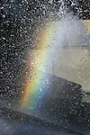 A rainbow affect seen in a public fountain on Market Street in San Francisco, California.