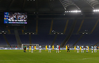 """Lazio and Hellas Verona teams observe a minute of silence in memory of late Italian player Paolo Rossi, seen on the screen, before the start of the Serie A soccer match between Lazio and Hellas Verona at Rome's Olympic Stadium, December 12, 2020.  The sentence on the screen reads """"Heroes never die"""".<br /> UPDATE IMAGES PRESS/Riccardo De Luca"""