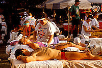 Ironman Triatholon contestants receive massage therapy after participating in grueling races.