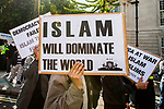 "© Joel Goodman - 07973 332324 . 11/09/2011 . London , UK . A man holds up a placard that reads "" Islam will dominate the world "" . Islamist organisation Muslims Against Crusades hold a demonstration outside the American Embassy in London on the tenth anniversary of Al-Qaeda's terrorist attack on the World Trade Centre in New York . Photo credit : Joel Goodman"