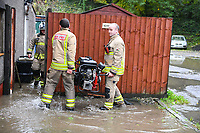 Flooding effected the villages of Aberdulais and Tonna in the Neath Valley after Storm Callum brought heavy rain and wind to the area cuasing the River Neath to reach bursting point.<br /> Fire Service carry a pump to a home in Canal Side, Tonna<br /> Saturday 13 October 2018