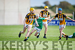 Abbeydorney's Mikey Clifford clears his defence despite athe attention from Ballyduffs Aodhan Curley in the Minor Hurling Championship semi final.