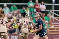 NEWTON, MA - MAY 22: Hannah Dorney #22 of Notre Dame brings the ball forward during NCAA Division I Women's Lacrosse Tournament quarterfinal round game between Notre Dame and Boston College at Newton Campus Lacrosse Field on May 22, 2021 in Newton, Massachusetts.