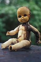 Old damaged black eyed doll<br />