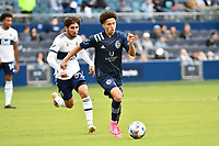 KANSAS CITY, KS - MAY 16: Cam Duke #28 Sporting KC with the ball during a game between Vancouver Whitecaps and Sporting Kansas City at Children's Mercy Park on May 16, 2021 in Kansas City, Kansas.