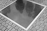 Shadows are cast on an underground memorial that marks the spot where the Nazis once held massive book burning rallies at the Bebelplatz in Berlin, Germany. Aug. 1, 2007.