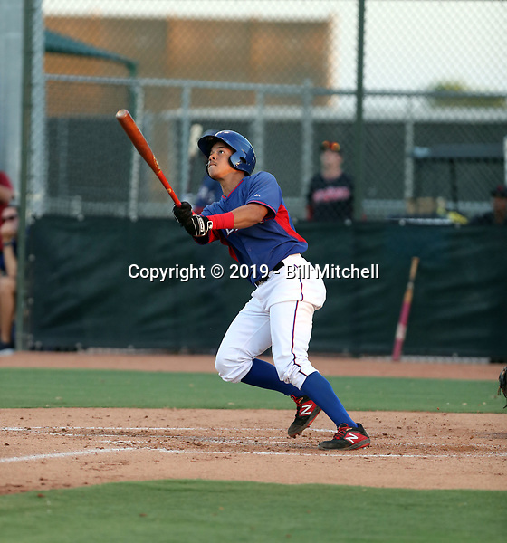 Heriberto Hernandez hits a third inning home run, his second in two days, to help the AZL Rangers defeat the Indians Blue team, 7-2, to capture the 2019 Arizona League championship with two straight wins. Game two was played at the Rangers complex in Surprise, Arizona on August 30, 2019 (Bill Mitchell)