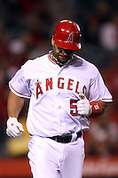 Albert Pujols #5 of the Los Angeles Angels shows his frustration after making an out against the Minnesota Twins at Angel Stadium on May 2, 2012 in Anaheim,California. Los Angeles defeated Minnesota 9-0.(Larry Goren/Four Seam Images)
