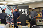 Houston Texans Ambassadors get ready to talk to the Worthing HS football team in honor of Black History Month.