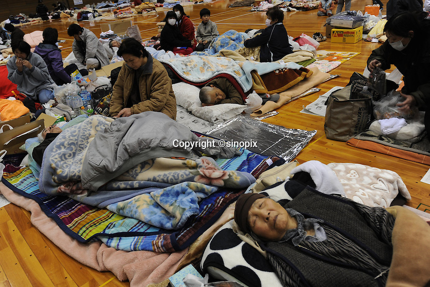 People sheltered at the Azuma Sports Complex in Fukushima, Japan. The gymnasiums, workout rooms and hallways of the  Azuma Sports Complex have been designated as shelter at Fukushima City, about 60 km from the Fukushima Daiichi Nuclear Power Plant. Plant was damaged during the  Earthquake and following Tsunami that struck Japan on 11 March 2011..17 Mar 2011..