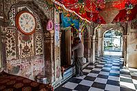 India, Dehradun.  Man Praying at the Entrance to the Inner Shrine of the Sikh Temple Durbar Shri Guru Ram Rai Ji Maharaj, built in 1707.