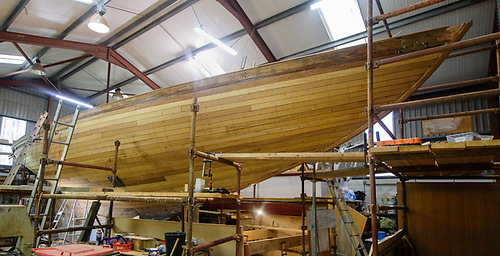 Work in progress – Northele as she is now in the shed in Crosshaven with the topside planking replaced, and much work done within