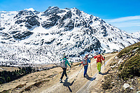 The Ortler Group in northern Italy is a popular region for spring ski touring using the huts for overnights to ski all the many peaks in the mountain group. Walking out of the Ortler Group in dry conditions.