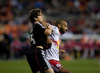 Dejan Jakovic (5) of D.C. United tries to stop Thierry Henry (14) of the New York Red Bulls from getting the ball during the game at RFK Stadium in Washington, DC.  D.C. United lost to the New York Red Bulls, 4-0.