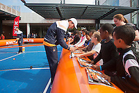 September 11, 2014, Netherlands, Amsterdam, Ziggo Dome, Davis Cup Netherlands-Croatia, Draw, Dutch players playing street tennis with kids in front off City Hall, pictured: Igor Sijsling signing autographs <br /> Photo: Tennisimages/Henk Koster
