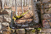 Remnants of Tripoli Mill which is along the old Woodstock & Thornton Gore Railroad in Livermore, New Hampshire USA. This mill dredged East Pond for diatomaceous earth in the early 1900s.