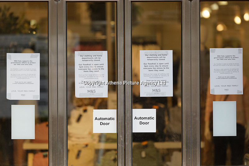 Pictured: Coronavirus information of the front door of the Marks and Spencer store in Neath, Wales, UK. Friday 27 March 2020<br /> Re: Covid-19 Coronavirus pandemic, UK.