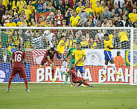 Brazil forward Jo (21) heads the ball away from goal off a corner kick.  In an International friendly match Brazil defeated Portugal, 3-1, at Gillette Stadium on Sep 10, 2013.