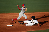 Clearwater Threshers shortstop Emmanuel Marrero (33) throws to first base on a double play attempt as Ty Moore (29) slides into second base during a game against the Bradenton Marauders on July 24, 2017 at LECOM Park in Bradenton, Florida.  Bradenton defeated Clearwater 6-3  (Mike Janes/Four Seam Images)