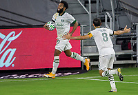 LOS ANGELES, CA - SEPTEMBER 13: Eryk Williamson #30 of the Portland Timbers scores a goal and celebrates with team mate Diego Valeri #8 during a game between Portland Timbers and Los Angeles FC at Banc of California stadium on September 13, 2020 in Los Angeles, California.