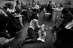 Alice Perreault-Steubing comforts Julius on the floor during an appropriations meeting. Lawmakers are discussing whether they will fund state services for disabled Utahns.<br />