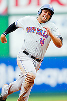 Matt Tuiasosopo #7 of the Buffalo Bison hustles towards third base against the Charlotte Knights at Knights Stadium on May 13, 2012 in Fort Mill, South Carolina.  The Bison defeated the Knights 7-6.  (Brian Westerholt/Four Seam Images)