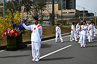 25th March 2021, Fukushima, Japan;  Japanese high school student Asato Owada holds the torch on the first day of the Tokyo 2020 Olympic torch relay in Futaba, Fukushima of Japan, on March 25th 2021.