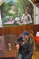 - Seborga, small village in province of Imperia (Liguria); some inhabitants, that  base themselves on presumed historical documents that go back to the age of the Templari knights, vindicate the constitution of the village in principality, independent from Italy, with an elect monarch and currency, documents and own automotive plates, naturally of no legal value ; inside of the village's cafe....- Seborga, piccolo paese in provincia di Imperia (Liguria); basandosi su presunti documenti storici che risalgono all'epoca de cavalieri Templari, alcuni abitanti rivendicano la costituzione del paese a principato indipendente dall'Italia, con un sovrano eletto e moneta, documenti e targhe automobilistiche proprie, naturalmente di nessun valore legale; l'interno del bar del paese..