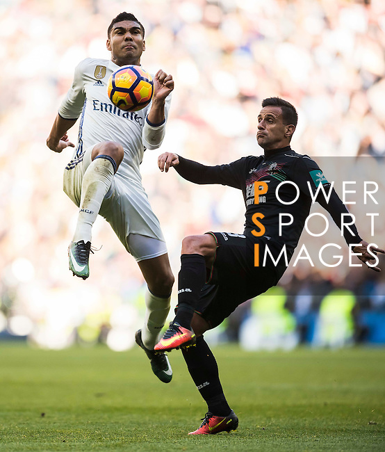 Carlos Henrique Casemiro (l) of Real Madrid in action while fighting for the ball with Javi Marquez of Granada CF during their La Liga match between Real Madrid and Granada CF at the Santiago Bernabeu Stadium on 07 January 2017 in Madrid, Spain. Photo by Diego Gonzalez Souto / Power Sport Images