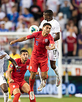 KANSAS CITY, KS - JUNE 26: Cristian Roldan #15 vie for a header Jose Fajardo #17 during a game between Panama and USMNT at Children's Mercy Park on June 26, 2019 in Kansas City, Kansas.