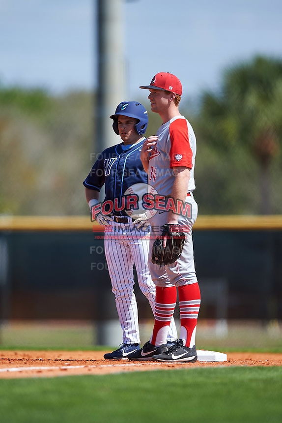 Ball State Cardinals first baseman Caleb Stayton (34) and base runner David Gulati (17) during a game against the Villanova Wildcats on March 3, 2017 at North Charlotte Regional Park in Port Charlotte, Florida.  Ball State defeated Villanova 3-1.  (Mike Janes/Four Seam Images)