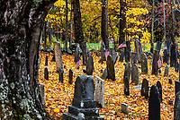 Rustic autumn cemetery, Salisbury, New Hampshire, USA.