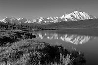 Mount McKinley and the Alaska Range reflect on the mirror surface of Wonder Lake on a clear summer morning.  A perfect scene of Denali such as this is a rare treasure to be enjoyed.