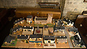 """08/12/16<br /> <br /> GV of cake village.<br /> <br /> In this incredibly detailed replica of a small Peak District village, everything is edible, from the baubles on the Christmas trees to the flowers around the houses and what's more the """"village"""" is made from 35 individual rich fruit Christmas cakes which will be eaten on the 25th!<br /> <br /> The amazing model village is made up of 18 shops and houses, which are all realistic reproductions of the actual buildings found in Youlgreave, and is open to the public to view at All Saints' church, the main focal point of the miniature masterpiece.<br /> <br /> Retired florist Lynn Nolan, who decorated all the cakes, came up with the original idea as a way of raising money for the church, which needs a new roof, and the first of the cakes went in the oven back in April.<br /> <br /> MORE...https://fstoppressblog.wordpress.com/the-village-thats-really-a-christmas-cake/<br /> <br /> All Rights Reserved F Stop Press Ltd. (0)1773 550665   www.fstoppress.com"""