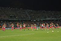 MEDELLIN - COLOMBIA, 05-02-2020: Jugadores del Huracán calientan previo al partido entre Atlético Nacional de Colombia y Huracán de Argentina por la primera fase, ida, de la Copa CONMEBOL Sudamericana 2020 jugado en el estadio Atanasio Girardot de la ciudad de Medellín. / Players of Huracan warm up prior a match between Atletico Nacional of Colombia and Huracan of Argentina for the first phase as part of Copa CONMEBOL Sudamericana 2020 played at Atanasio Girardot stadium of Medellin city. Photo: VizzorImage / Leon Monsalve / Cont