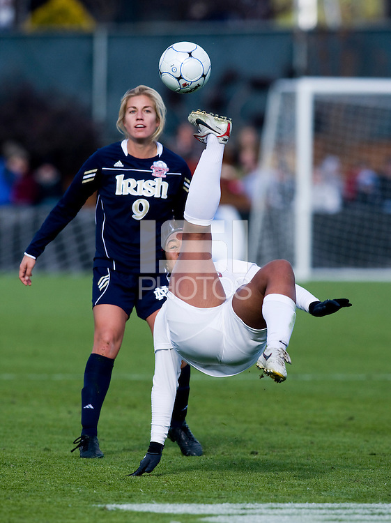 Mariah Nogueira (20) of Stanford bicycle kicks the ball over Lauren Fowlkes  (9) of Notre Dame during the final of the NCAA Women's College Cup at WakeMed Soccer Park in Cary, NC.  Notre Dame defeated Stanford, 1-0.