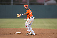 AZL Giants Orange second baseman Wascer De Leon (34) prepares to make a throw to first base during an Arizona League game against the AZL Athletics at Lew Wolff Training Complex on June 25, 2018 in Mesa, Arizona. AZL Giants Orange defeated the AZL Athletics 7-5. (Zachary Lucy/Four Seam Images)