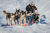 Ralph Johannessen and team run up the bank of the Yukon River to the Kaltag checkpoint on Saturday March 12th during the 2016 Iditarod.  Alaska    <br /> <br /> Photo by Jeff Schultz (C) 2016  ALL RIGHTS RESERVED