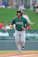 Designated hitter Miguel Gomez (9) of the Augusta GreenJackets scores on a home run in a game against the Greenville Drive on Thursday, June 9, 2016, at Fluor Field at the West End in Greenville, South Carolina. Augusta won, 8-2. (Tom Priddy/Four Seam Images)