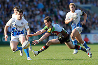 Tom Williams of Harlequins lunges for a loose ball as Dan Hipkiss of Bath Rugby looks on during the Aviva Premiership match between Harlequins and Bath Rugby at The Twickenham Stoop on Saturday 24th March 2012 (Photo by Rob Munro)