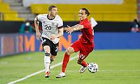 2nd June 2021, Tivoli Stadion, Innsbruck, Austria; International football friendly, Germany versus Denmark; Robin Gosens Germany and Yussuf Poulsen Denmark