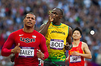 05 AUG 2012 - LONDON, GBR - Usain Bolt (JAM) of Jamaica (centre) celebrates winning his men's 100m semi final during the London 2012 Olympic Games athletics in the Olympic Stadium at the Olympic Park in Stratford, London, Great Britain (PHOTO (C) 2012 NIGEL FARROW)