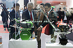 December 30, 2011, Tokyo, Japan - Press members look at Honda Motor Co.'s display of gardening equipment during the 42nd Tokyo Motor Show. The show opens to the general public from December 3-11. (Photo by Christopher Jue/AFLO)
