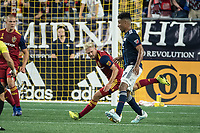 FOXBOROUGH, MA - SEPTEMBER 21: Kelyn Rowe #6 of Real Salt Lake comes in to tackle Juan Agudelo #17 of New England Revolution during a game between Real Salt Lake and New England Revolution at Gillette Stadium on September 21, 2019 in Foxborough, Massachusetts.