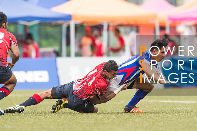 Hao–Wei Chang (r) of Chinese Taipei fights for the ball with Mohd Khairul Amrie Jafree (l) of Malaysia during the match between Malaysia and Chinese Taipei of the Asia Rugby U20 Sevens Series 2016 on 12 August 2016 at the King's Park, in Hong Kong, China. Photo by Marcio Machado / Power Sport Images