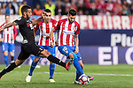 Yannick Ferreira Carrasco of Atletico de Madrid competes for the ball with Ruben Miguel Nunes Vezo of Granada CF during their La Liga match between Atletico de Madrid and Granada CF at the Vicente Calderon Stadium on 15 October 2016 in Madrid, Spain. Photo by Diego Gonzalez Souto / Power Sport Images