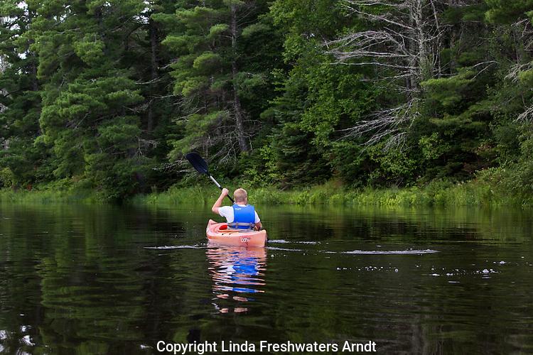 Teenager kayaking down the Flambeau River