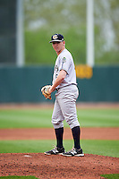 Kane County Cougars relief pitcher Cameron Gann (15) gets ready to deliver a pitch during the first game of a doubleheader against the Cedar Rapids Kernels on May 10, 2016 at Perfect Game Field in Cedar Rapids, Iowa.  Kane County defeated Cedar Rapids 2-0.  (Mike Janes/Four Seam Images)