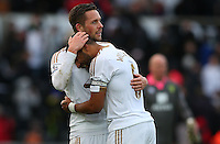Gylfi Sigurdsson and Ashley Williams of Swansea City celebrate at full time during the Barclays Premier League match between Swansea City and Norwich City played at The Liberty Stadium, Swansea on March 5th 2016